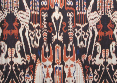 The Royal Cloth (Kain Maramba) (Unknown artist): Dutch cotton, indigenous natural dyes (Mengkudu root, Indigo plant): weaving, Ikat technique with supplementary warp edges. $10,000