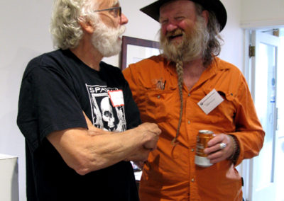 Bill Dorman speaking to another artist