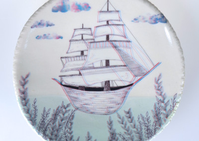 Jenn Demke-Lange. Bon Voyage. 2015. Porcelain, glazes; Hand-built, glaze, illustrated anaglyph decals. $95.
