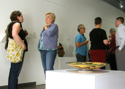 Ceramic artist Carole Epp chatting with Kathy Allen