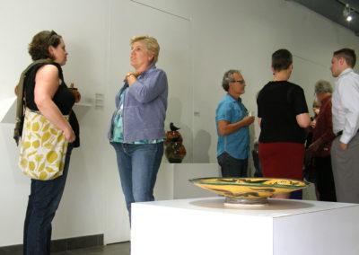 Ceramic artist Carole Epp chatting with Kathy Allen