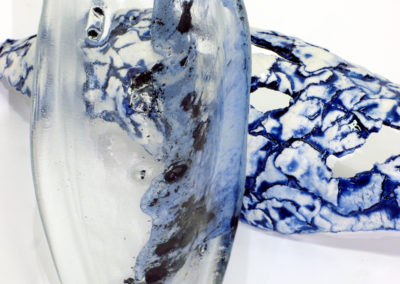 Intransit Variation #5 (Paula Cooley & Louisa Ferguson), 2016:  Glass, porcelain, cobalt oxide, epoxy; cast glass, hand built, fired to cone 06 ox. $600.