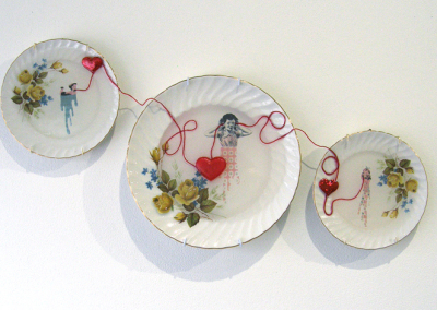 Lost in Translation (Carole Epp), 2014: Vintage dishes, custom made decals, resin; found objects, collage work with vintage illustrations, watercolour and paper turned into decals, fired, resin coated. $120