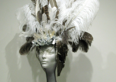 Enlightened (Cassie-Danielle Roteski): Feathers, mirror, metal, fabric, crystals, leather, metal leaf. $500.