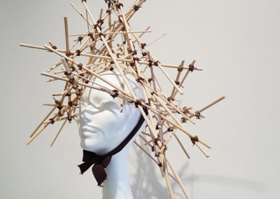 The Insomniac's Thinking Cap (Paula Cooley, Saskatoon, SK), 2017: Wooden dowel, bamboo skewers, cord, tar gel; assembled and tied. $540. 1st Place Winner – Headpiece.