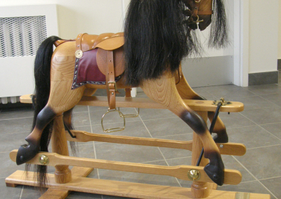 Traditional English Rocking Horse on Glider Stand (Ed Schille), 2010: Sold red Oak, horse hair, authentic leather English tack and hardware; carved. $2,800