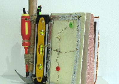 Emma Bound Survival Book (Elizabeth Babyn, Saskatoon, SK, Canada), 2016: Wire, string, paper, rubber, wood, metal. $175.
