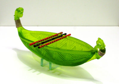 Chopstick Waka/Canoe (Shona Firman), 2016:  Green gaffer 40% lead crystal glass, chopsticks, waxed binding; kiln cast, carved. $1,700.