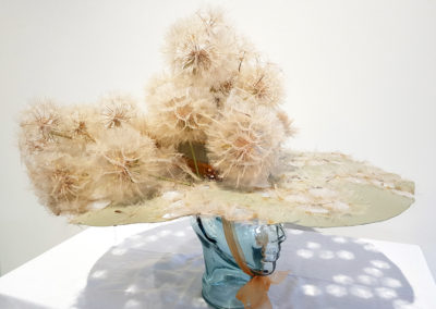First Love ( Monique Martin and Len Thomas, Saskatoon, SK), 2017: Goat's beard weed parachutes, paper, glue, paint, ribbon, broken jewellery; collage, papier-mâché. $250.