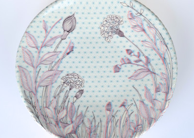 Jenn Demke-Lange. Forget-Me-Not. 2015. Porcelain, glazes; Hand-built, glaze, illustrated anaglyph decals. $95.