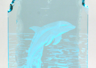 Dolphin (Harvey Heshka), 2003:  13 mm and 19 mm glass, mirror; multi-stage carved, sandblasted, laminated. Not for sale.