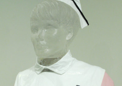 The Glass Nurse (Joan & Al Heibert), 2016:  Glass, metal, plexiglass, fiberglass and Paverpol stiffener, SCH uniform circa 1960's; casted, molded. Not for sale.