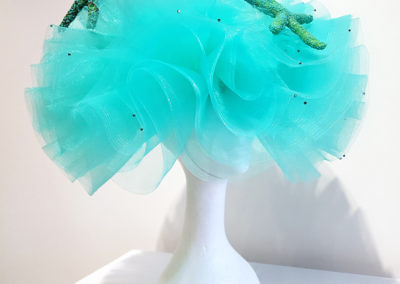 Beach Babe (Sherri Hrycay, Saskatoon, SK), 2017: Horse hair, thread, starfish, beads, glue, sinamay, elastic; hand sewn. $300.