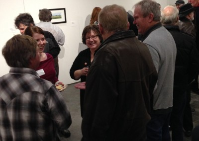 SCC Executive Director Carmen Milenkovic visits with guests and artists.