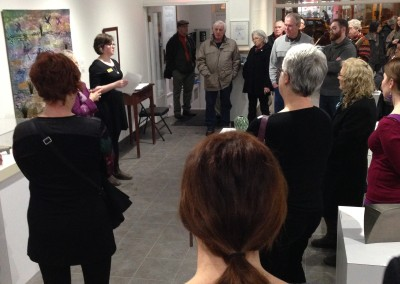 SCC Exhibitions Coordinator Maia Stark speaks to the crowd at the Dimensions Reception.