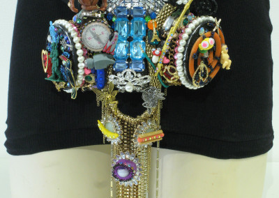 Family Jewels (Jennilee Cardinal-Schultz): Upcycled gas mask, jewelry, toys, junk. Not for sale.