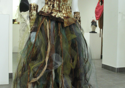 Sylvana (Ester Knight and Cindy Obuck): Hand felted and dyed Wool, Silk, Tulle and Leather, suede lacing, wood buttons. $700.