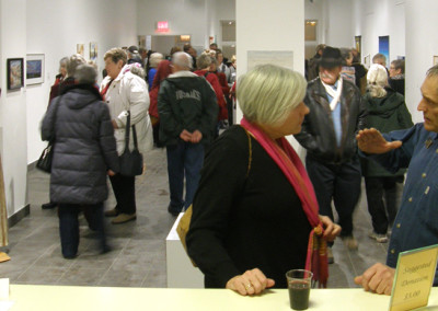 Leslie Potter in conversation with an Opening Reception guest.