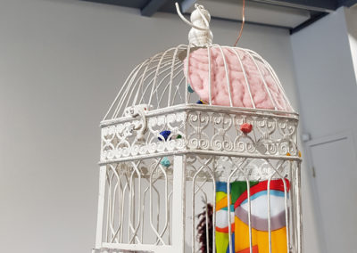 Let's Talk ( Elisabeth Miller, Robert Miller, and Kelsey Murphy, Saskatoon, SK), 2017: Metal birdcage, foam, fabric, fishing line, aluminum bar, acrylic paint, glass paint, sheet and stringer glass; found, purchased, and combined materials, cut glass, painted, fused. $600.