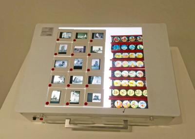 Light box displaying slides from Hans Dommasch and a private collector.