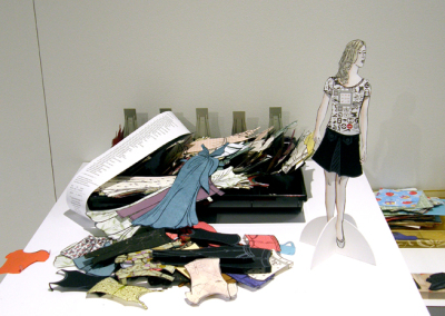 Paper Doll - Affluenza (Monique Martin), 2014: Ink on various papers, mat board; linocut, assembly. $275