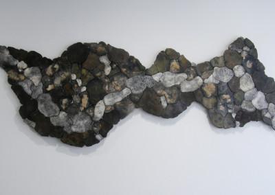 It's Not the Destination, It's the Journey (Thelma Howard & Lorraine Sutter), 2015: Porcelain, paper clay, pebbles, glue, masonite, sopper sulphate, borax. $3000.