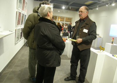 Reception: SCC Artist Paul Lapointe chatting with long time patrons.