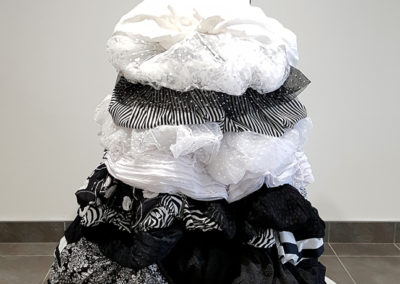 The Wedding Dress (Melissa Squire, Saskatoon, SK), 2014: Cotton sateens, tulle, cotton, heavy duty upholstery mesh, recycled bike tire, snaps, lace, ostrich feather trim, boning, ribbon; sewing, studding. NFS. Feature Piece - 2017 Swag Juror.