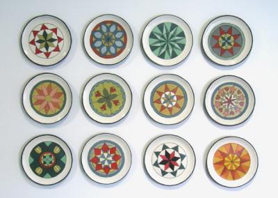 Cathy Terepocki. Kitchen Quilt, 2015, Black clay, porcelain slip, coloured underglaze and coloured slip; screen-printed using slip-transfer method (plaster, hand-painted), Not For Sale.