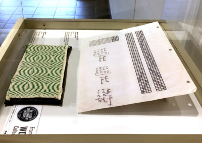 Sampler (Algerta Armstrong), 1940's: Green and white pattern sampler. Collection of the Western Development Museum.
