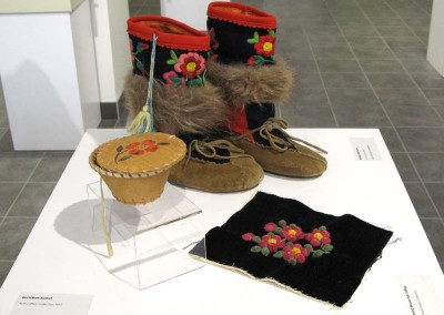 """Mukluks with Tassels"" Leah Dorion Collection, Worn by Leah Dorion; ""Birch Bark Basket"" Leah Dorion Collection; ""Unframed Moose Hair Tufting"" Leah Dorion Collection"