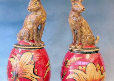 33. 32. Jackrabbit Jars (Debra Kuzyk and Ray Mackie), 2016: Cone 6 porcelain; carved decoration. $1,200 (left), Not for sale (right).