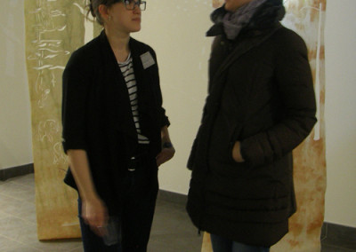 Artist Rowan Pantel with guest at Cynefin reception.