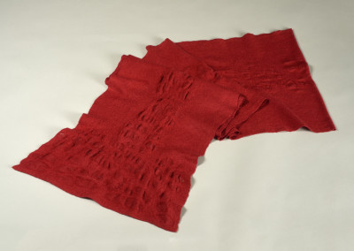 "Award for Excellence in Textiles: Gwen Klypak (Saskatoon) ""Red Scarf"", 2015; Merino wool, silk, Sodium Alginate; handweaving, felting, applying resists; 150 x 38-43; Value: $400.00; Not For Sale"