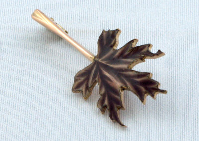 Maple Leaf (Joan Thomson), 2015: 14k rose gold, 14k pin, commercial finding, enamel; basse-taille. $1,580.