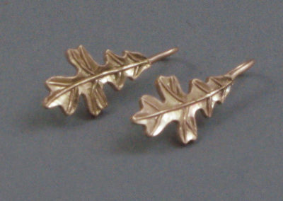 Red Oak Leaves (Joan Thomson), 2016: 14k red gold. $1,080.