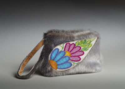 Beaded Sealskin Clutch Bag (Marcy Bast), 2017: Glass beads, Canadian ringed seal hide, smoked moosehide, satin, wool; hand beading embroidery, hand stitching, machine sewing. $600