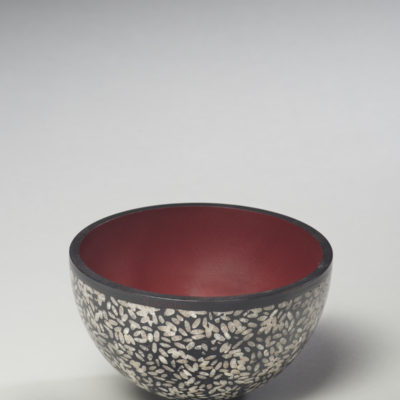 """""""Rice Bowl"""" Michael Hosaluk. 2017. Maple, sushi rice, acrylic gel, molding paste, gesso, milk paint; woodturned bowl, riced adhered with gel, filled with black paste, sanded, finished with super glue and wax. $350."""