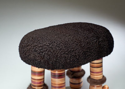 Mink Muff Footstool (Sarah Lightfoot Wagner), 2017: Repurposed Persian lamb coat, variety of wood types; laminating, turning, carving, foam core upholstery. $650 Not for sale.