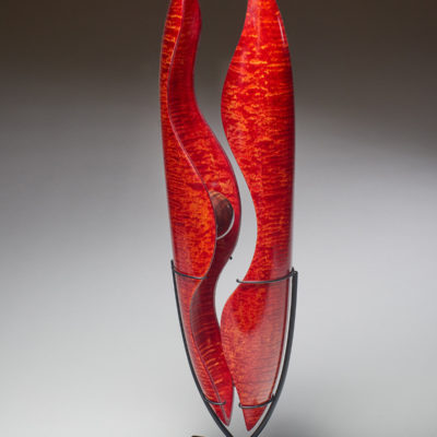 """""""Father and Mother with Child"""" Dale Lowe. 2016. Figured Maple, dye, steel, powder coat; turned and carved. $2,200."""