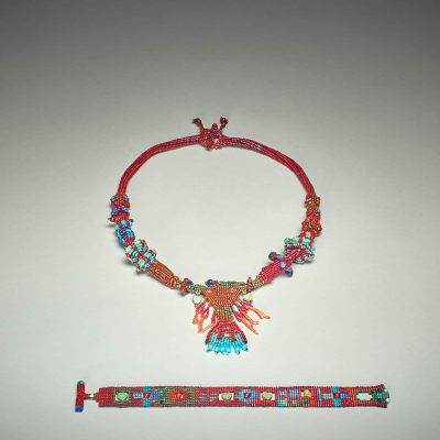 """""""Finding Diversity in Balance: Earthday Wear"""" Oriol Dancer. 2017. Beads (tourquoise, carnelian, coral, red hearts, brass, glass, and delicas), thread; Ndebele, square, ladder, brick, peyote stitches. $400."""
