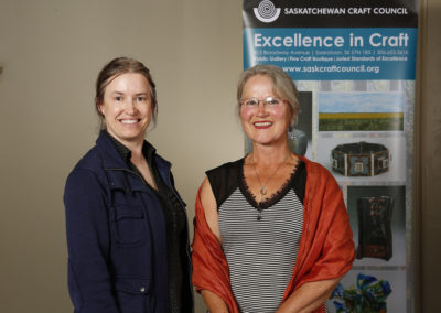 "Artist Marcy Bast, winner of the ""Award for Excellence in Fine Craft,"" with Award Presenter June Jacobs."