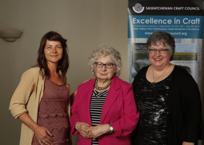 "Laura Hosaluk and Ruby Hosaluk, who accepted the ""Dimensions 2017 Award for the Outstanding Entry"" on behalf of Michael Hosaluk, with Award Presenter and SCC Executive Director Carmen Milenkovic."