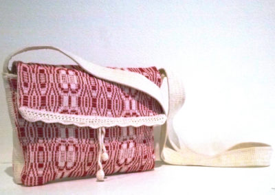 Shoulder Flap Bag (Sanette Crafford), 2017: Cotton; Beriau Bags – a Prairie Wool Weavers Group Project. Woven from the pattern called Varietes in the Oscar Beriau Home Weaving book. This is a tradition overshot pattern woven with non –traditional wefts that are thinner than usual and also with some with variations in the use of tabby. NFS