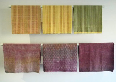 "Top three: Tea Towel (Jonina Male), 2016: Cotton warp and weft; plain weave, adaptations of Oscar Beriau design p. 290 originally a design for upholstery. $40; Bottom three: Handwoven Towel (Kathleen Bower), 2017: Hand painted cotton (Procion MX dyes), commercial cotton, linen; Oscar Beriau draft, page 137: ""Combination"". NFS"