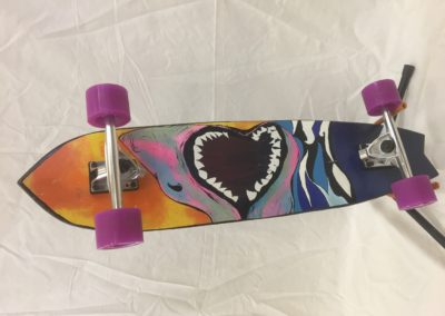 Longboard with Shark Graphics:  Kelly Peters