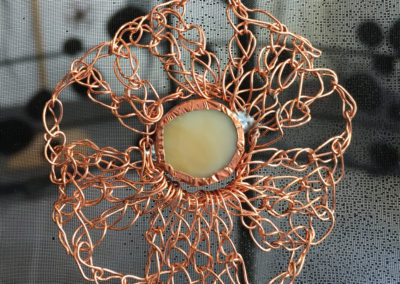 The Mettle She is Made Of (Louisa Ferguson, Meacham, SK), 2017: Copper, felt, tule, voile, thread; sewing, appliqué, copper wire crochet. $900.