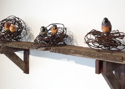 From Where Do They Speak?/D'ou proviennent leurs conseils? (Claude A Morin), 2016: Porcelain, underglaze, weathered wood; salt and gas fired handmade birds, arranged wire and woodwork. 55 x 87 x 28 cm. $2000