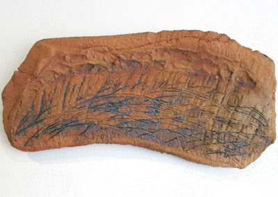 A Grassland Dance 3/La dance de la prairie 3 (Claude A Morin), 2016: Stoneware clay, oxides; gas fired pieces treated with oxides. 22 x 42.5 x 2 cm. $200