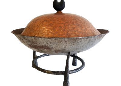 Tanzania Wok (Greg Wilbur, Daryl Richardson, Thierry Martenon, Ted Crosfield), 2004: Iron, tin, copper, walnut. Collection of Sandra and Glen Grismer.
